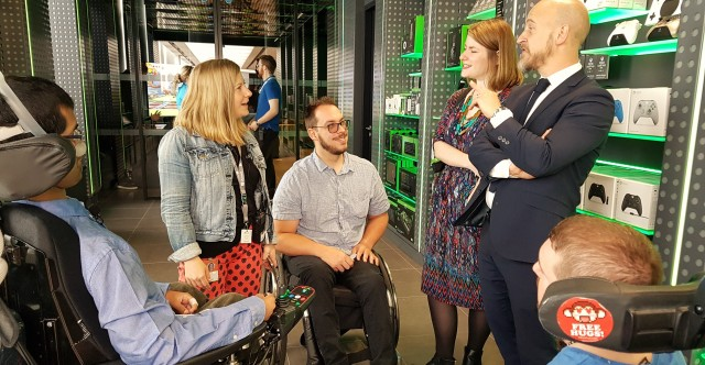 Group of us talking to Hector Minto outside the inclusive gaming room