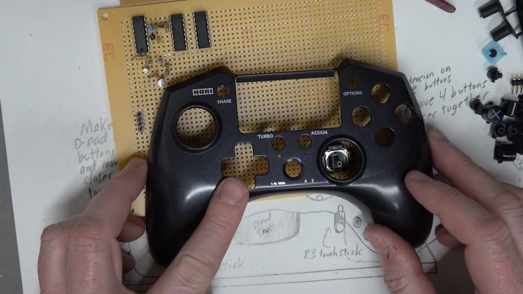 The front panel of a Horipad PS4 controller.