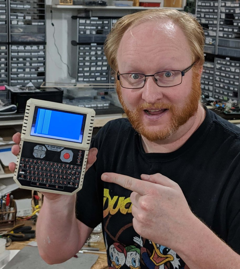 Ben Heck pointing at some retro technology.