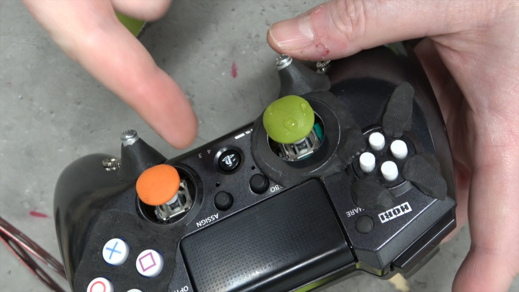 Ben Heck pointing at my custom controller's orange and green Sugru stick toppers.