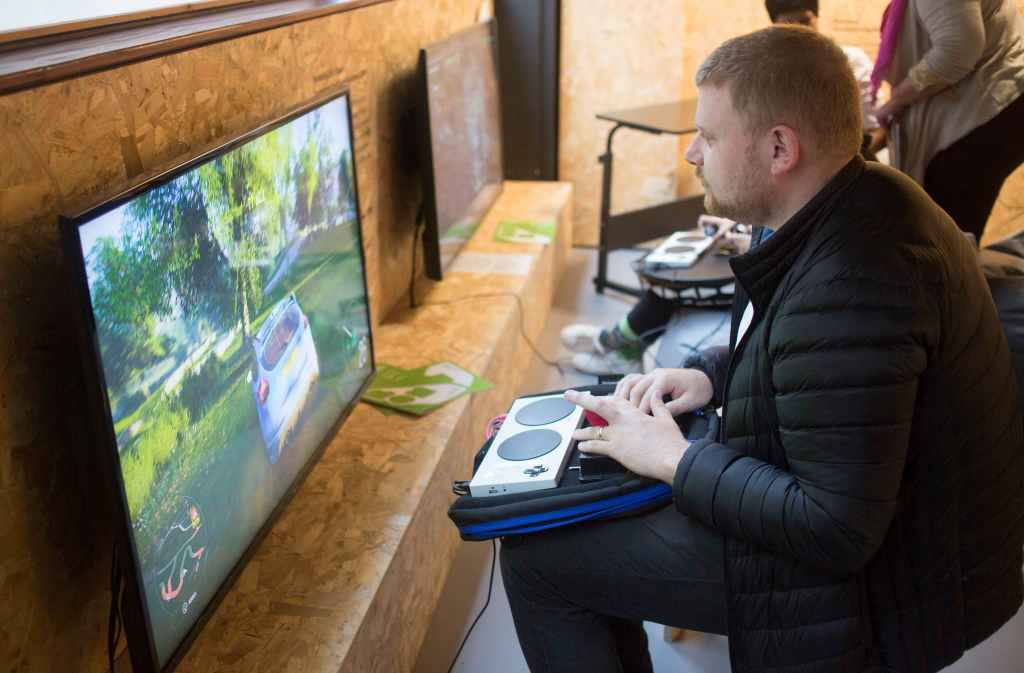 Watching a gamer play Forza Horizon 4 using the Xbox Adaptive Controller with switches and joystick   Pictures credited to Alison Baskerville / BOM